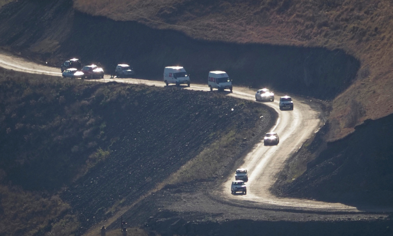Cars with people leaving the separatist region of Nagorno-Karabakh to Armenia approach the border of Armenia on Nov 8. — AP