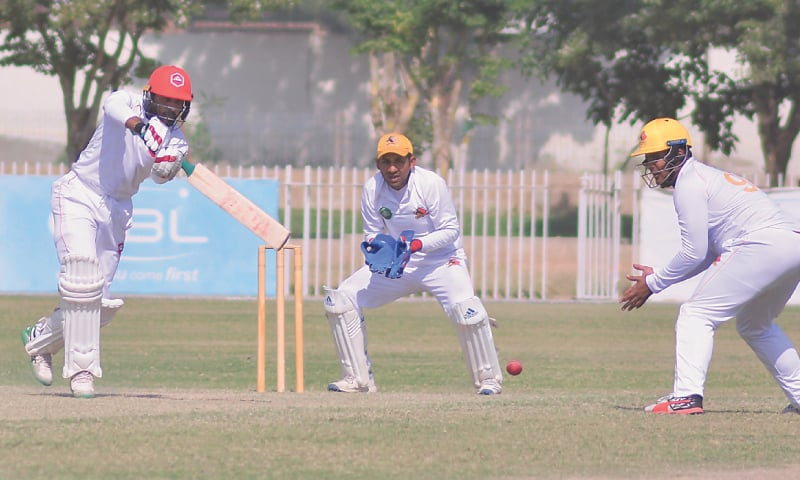 NORTHERN'S Sarmad Bhatti drives on his way to 108 as Sindh captain Sarfaraz Ahmed looks on during the third-round match at the UBL Sports Complex on Sunday.—Courtesy PCB