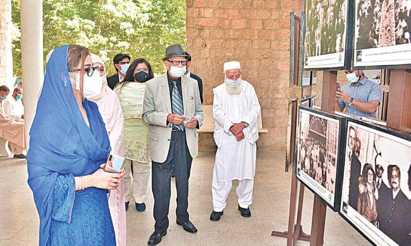 PHOTOGRAPHS of Iqbal on display at KU on Monday.—APP