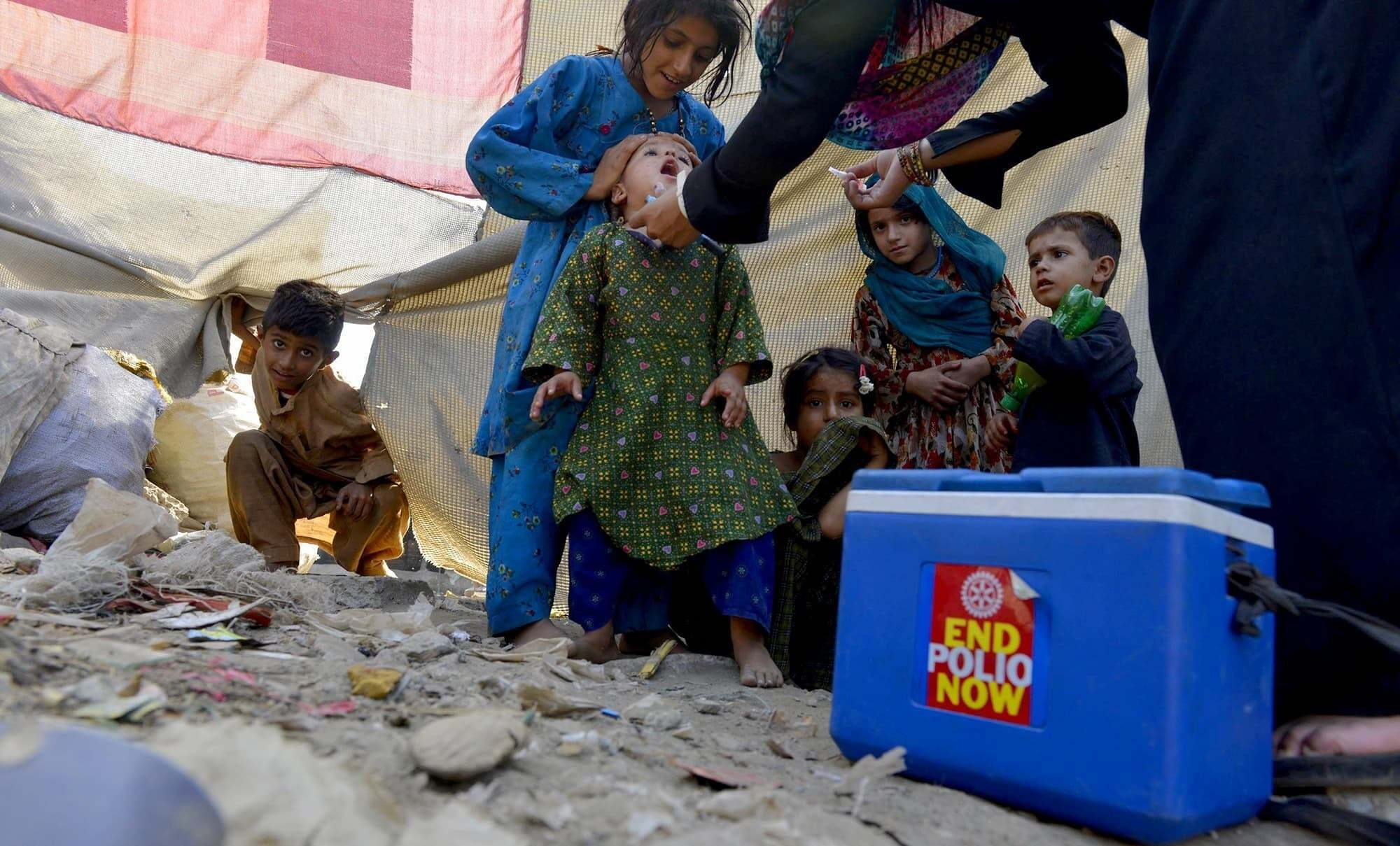A large number of union council polio officers protested outside the World Health Organisation office, demanding an extension in the contracts of 1,800 officers.— AFP/File