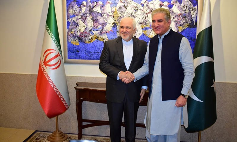 Foreign Minister Shah Mahmood Qureshi and Iranian Foreign Minister Javad Zarif shake hands before a meeting in May, 2019. — Photo courtesy Naveed Siddiqui/File