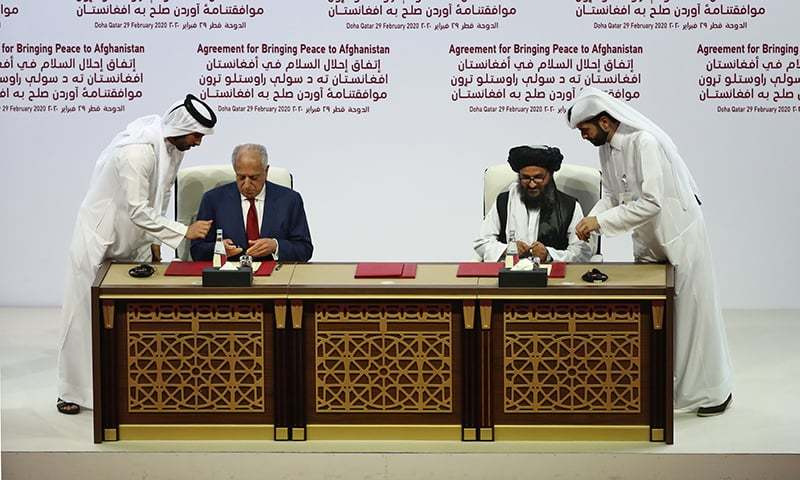 (L to R) US Special Representative for Afghanistan Reconciliation Zalmay Khalilzad and Taliban co-founder Mullah Abdul Ghani Baradar sign a peace agreement during a ceremony in the Qatari capital Doha on February 29, 2020. The United States signed a landmark deal with the Taliban, laying out a timetable for a full troop withdrawal from Afghanistan within 14 months as it seeks an exit from its longest-ever war. — AFP