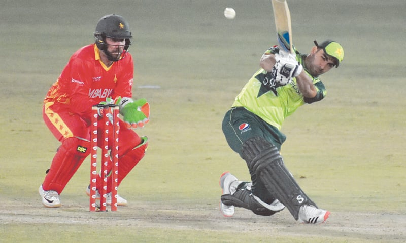 KHUSHDIL Shah plays a lofted shot during his whirlwind knock as wicket-keeper Brendan Taylor looks on.—White Star
