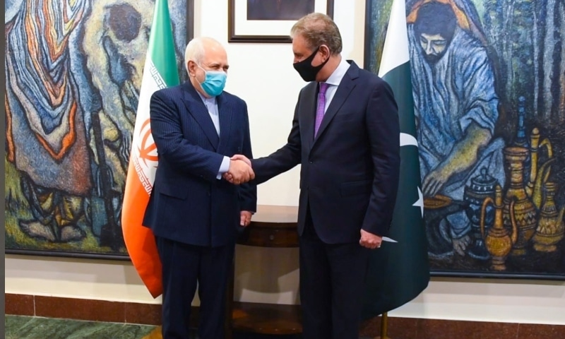 Foreign Minister Shah Mahmood Qureshi (right) shakes hands with Iranian counterpart, Javad Zarif, on Wednesday. — Photo provided by Naveed Siddiqui