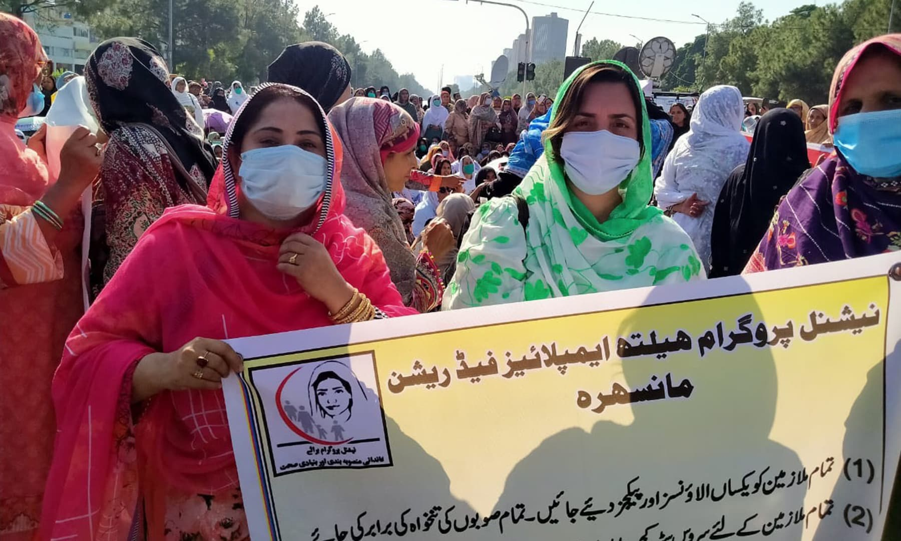 Lady Health Workers from across the country staged a protest sit-in in Islamabad last month seeking their regularisation. — Photo by author