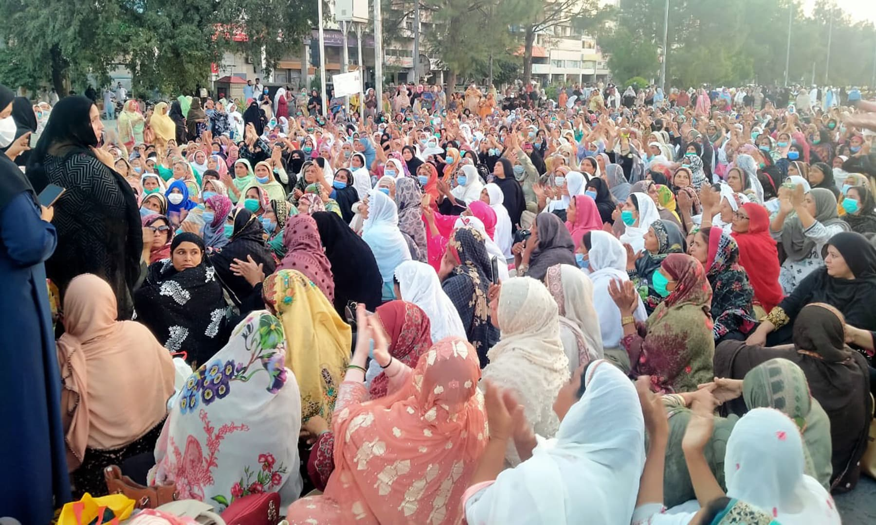 Health workers participate in a sit-in in Islamabad seeking their regularisation in October. — Photo by author
