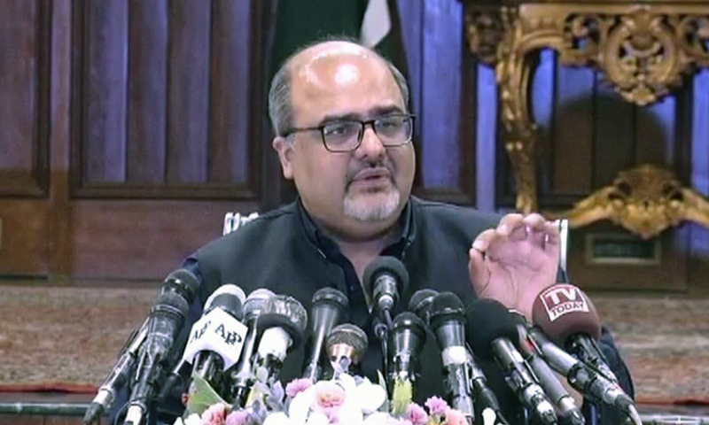 Special Assistant to the PM on Accountability and Interior Shahzad Akbar addresses a press conference in Lahore. — DawnNewsTV