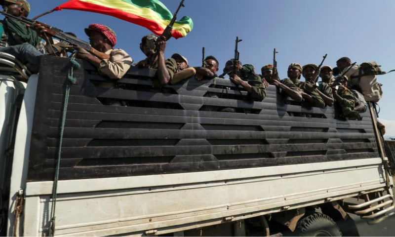 Members of Amhara region militias ride on their truck as they head to face the Tigray People's Liberation Front (TPLF), in Sanja, Amhara region near a border with Tigray, Ethiopia on Nov 9. — Reuters
