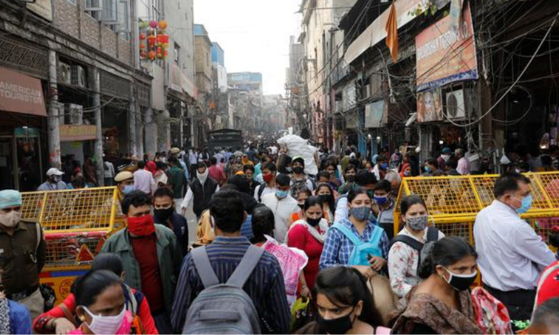 Shoppers crowd at a market ahead of the Hindu festival of Diwali, amidst the spread of the coronavirus, in the old quarter of Delhi, India on Tuesday. — Reuters