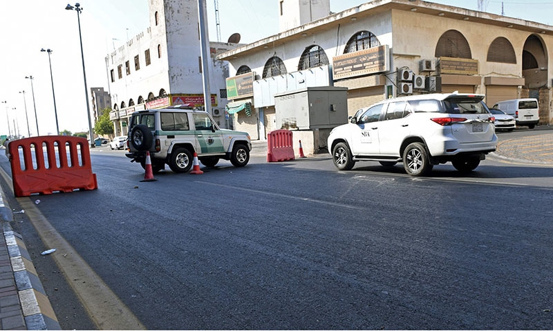 Saudi police close a street leading to a non-Muslim cemetery in the Saudi city of Jeddah where a bomb struck a World War I commemoration attended by European diplomats on November 11, 2020 leaving several people wounded. — AFP