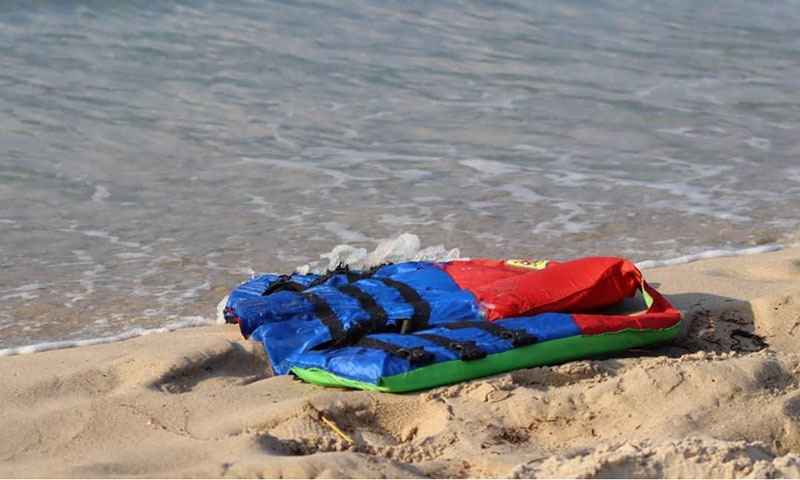 In these photos taken on Nov. 12, 2020, life jackets litter the beach off the coast of Libya near the port of Khoms.  Several migrants drowned after their Europe-bound ship broke down off the coast of Libya on Thursday, the UN migration agency said, in the latest in a series of at least eight shipwrecks in the Central Mediterranean since last month.  — AP