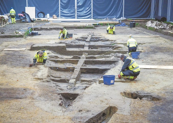 This handout picture released by the Museum of Cultural History shows the remains of a rare Viking ship grave seen from the northern stern being excavated by archaeologists at the site in Walden, Norway.—AFP