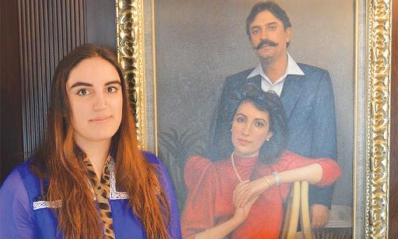 Bakhtawar Bhutto-Zardari standing next to the portrait of her parents Benazir Bhutto and Asif Ali Zardari. — File photo