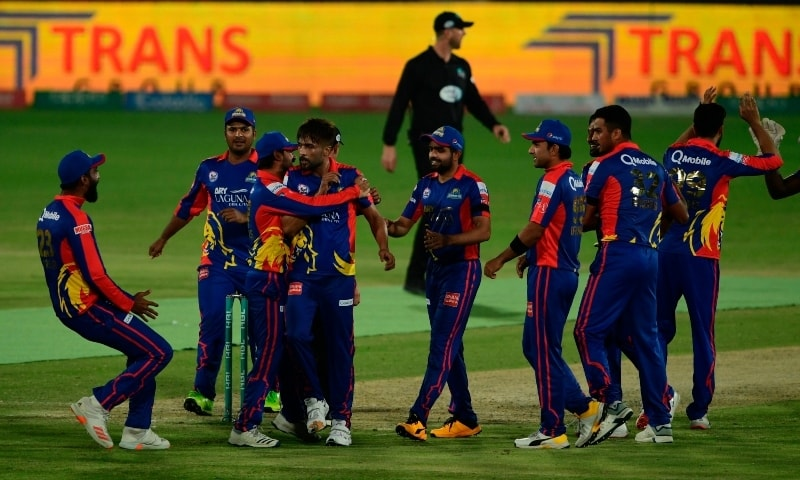 Karachi Kings' cricketers celebrate after winning their Pakistan Super League (PSL) Twenty20 cricket match against Multan Sultans at the National Stadium in Karachi on Saturday. — AFP