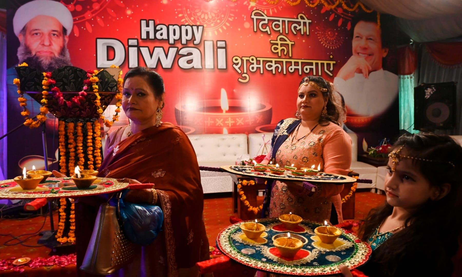 Hindu women celebrate Diwali at Krishna Mandir in Lahore on November 14. — AFP