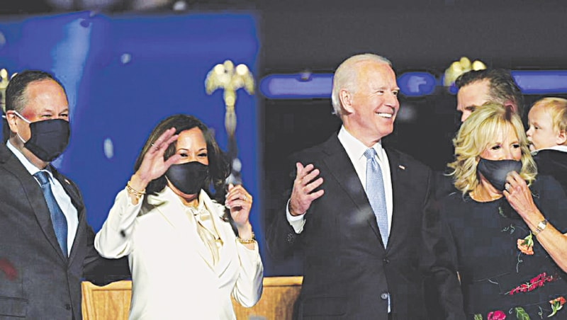 Joe Biden, his wife Jill (right), Kamala Harris and her husband Doug (left) celebrate | AP