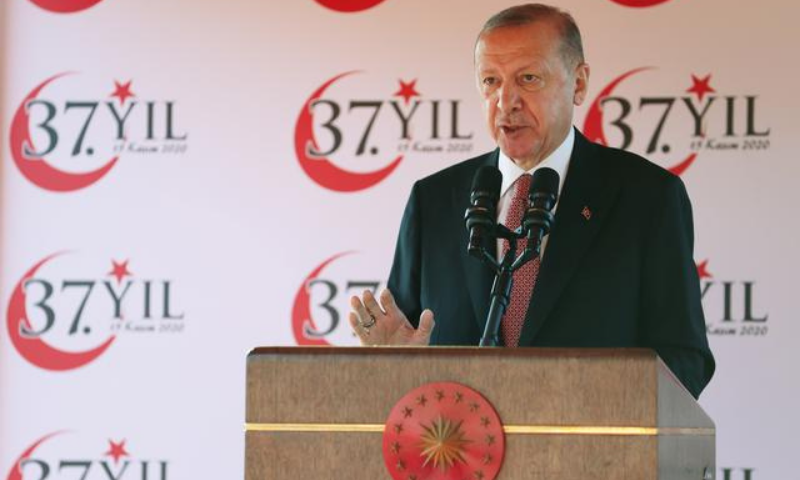 Turkish President Recep Tayyip Erdogan addresses the audience as he attends a ceremony marking  the 37th anniversary of the self-proclaimed Turkish Republic of Northern Cyprus (TRNC) .