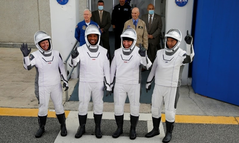 Crew members of a SpaceX Falcon 9 rocket commander Mike Hopkins, Victor Glover, Shannon Walker and Japanese astronaut Soichi Noguchi, gesture as they depart for the launch pad for the first operational Nasa commercial crew mission on Nov 15.  —  Reuters