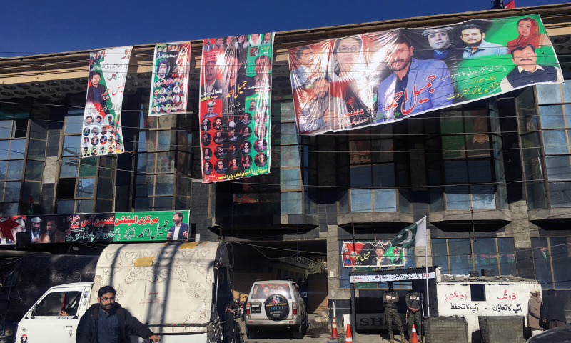 Election campaign banners of different political parties are seen on a building ahead of the legislative assembly elections in the city of Gilgit, Gilgit Baltistan on Nov 8. — AFP/File