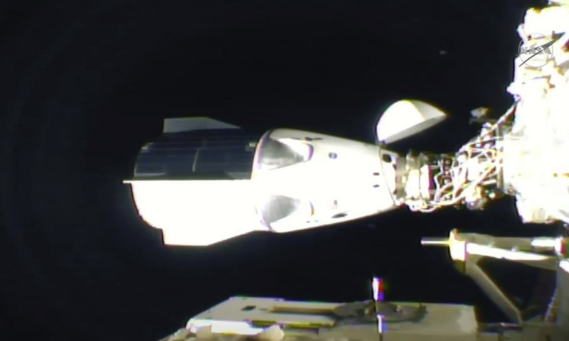 In this frame grab from NASA TV, the SpaceX Dragon is seen after docking at the International Space Station late on Monday. — AP
