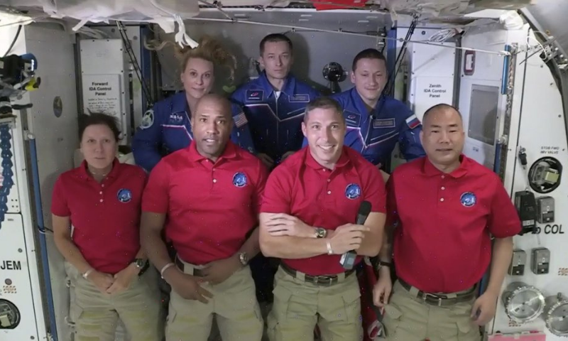 In this frame grab from NASA TV, SpaceX Dragon crew, from front left to right, Shannon Walker, Victor Glover, Mike Hopkins and Soichi Noguchi stand with International Space Station crew Kate Rubins, from back left, Expedition 64 commander Sergey Ryzhikov and Sergey Kud-Sverchkov during a welcome ceremony early on Tuesday. — AP