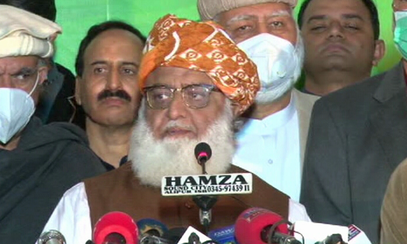 JUI-F chief Maulana Fazlur Rehman talks to reporters in Islamabad after a PDM meeting. — DawnNewsTV