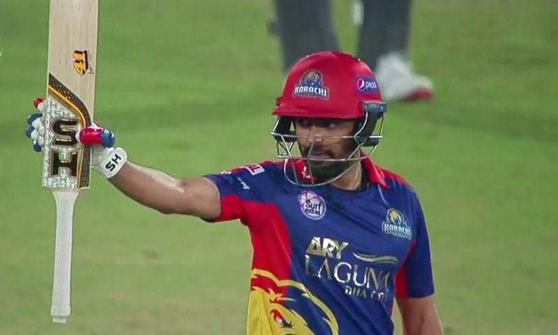 Karachi Kings batsman Babar Azam raises his bat to celebrate his 50. — DawnNewsTV