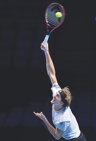 GERMANY'S Alexander Zverev serves against Daniil Medvedev of Russia during their round-robin match of the ATP Tour Finals at the O2 Arena.—AFP
