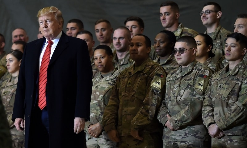 In this 2019 file photo, US President Donald Trump speaks to US troops during a surprise Thanksgiving day visit at Bagram Air Field in Afghanistan. — AFP