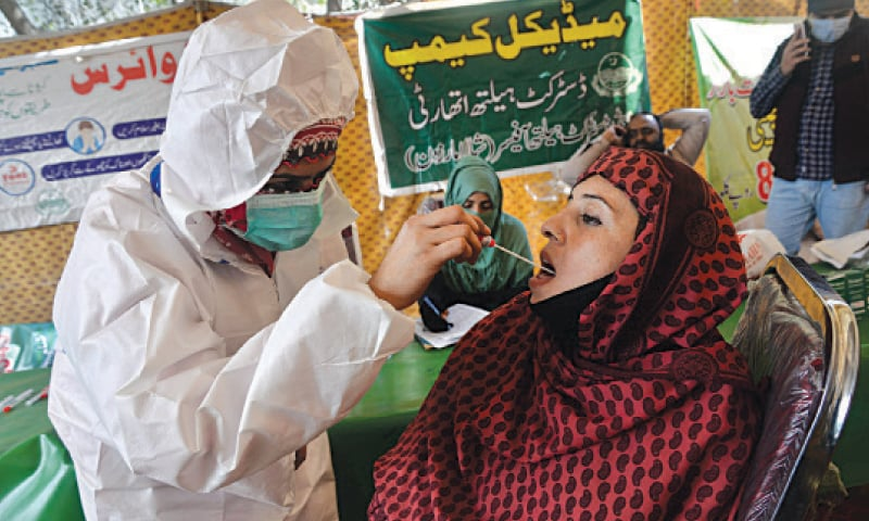 Health staff conduct random tests for Covid-19 at a Sahulat Bazar on GT Road. — White Star