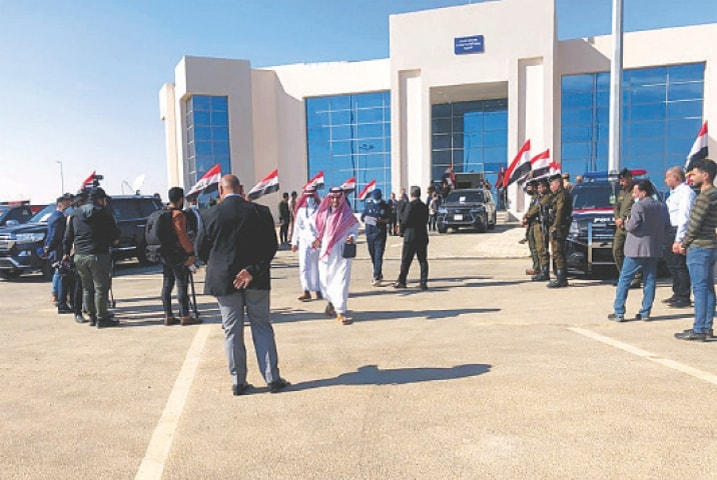 Iraqi and Saudi officials open the Arar border crossing in Anbar on Wednesday.—AP