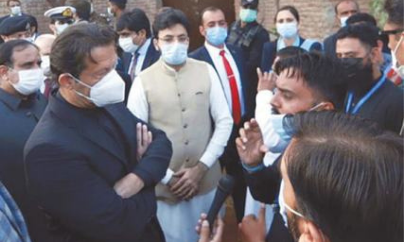 FAISALABAD: Prime Minister Imran Khan interacts with factory workers on Wednesday. — PPI