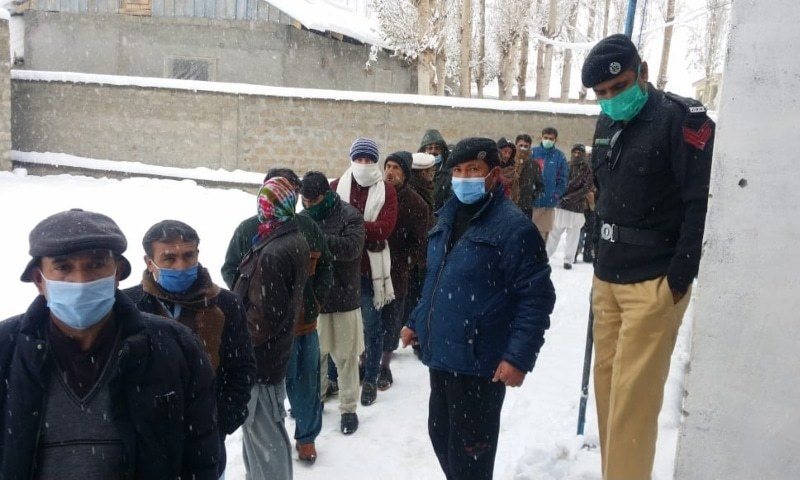Voters line up outside a polling station in Ghizer. — Photo courtesy Umar Bacha/File