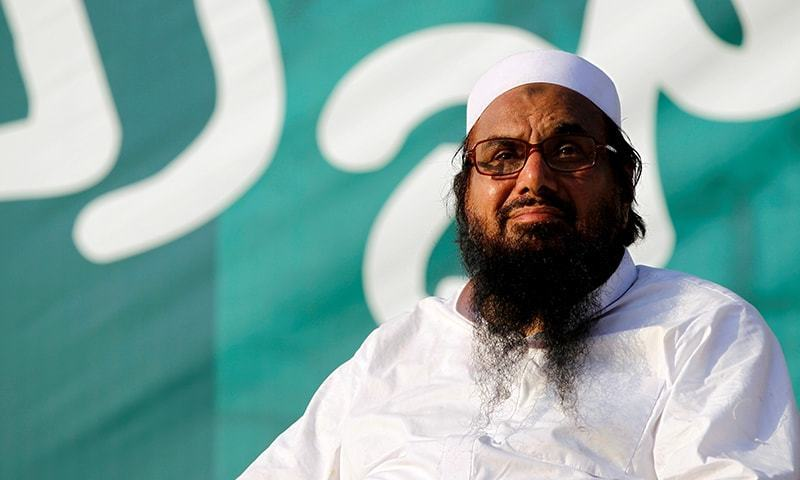 "Hafiz Muhammad Saeed, chief of the banned Jamatu Dawa, looks over the crowd as they end a ""Kashmir Caravan"" from Lahore with a protest in Islamabad on July 20, 2016. — Reuters/File"