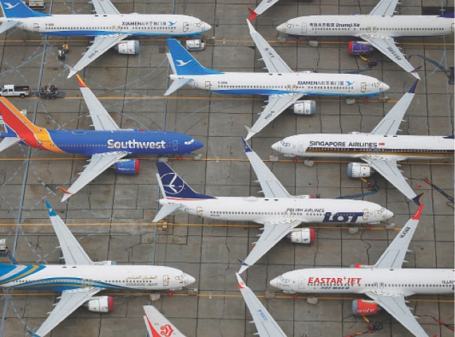 SEATTLE (US): Grounded Boeing 737 MAX aircraft are seen parked at Boeing facilities at Grant County International Airport.—Reuters