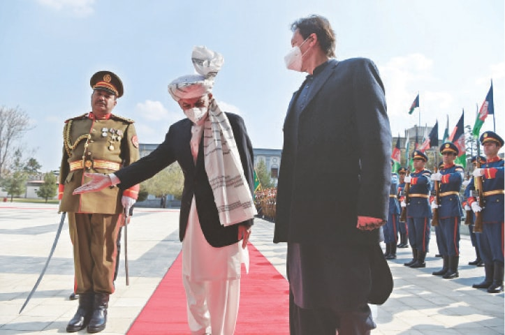KABUL: Afghan President Ashraf Ghani gestures to Prime Minister Imran Khan during a guard of honour ceremony ahead of their joint press conference at the Presidential Palace on Thursday.—AFP