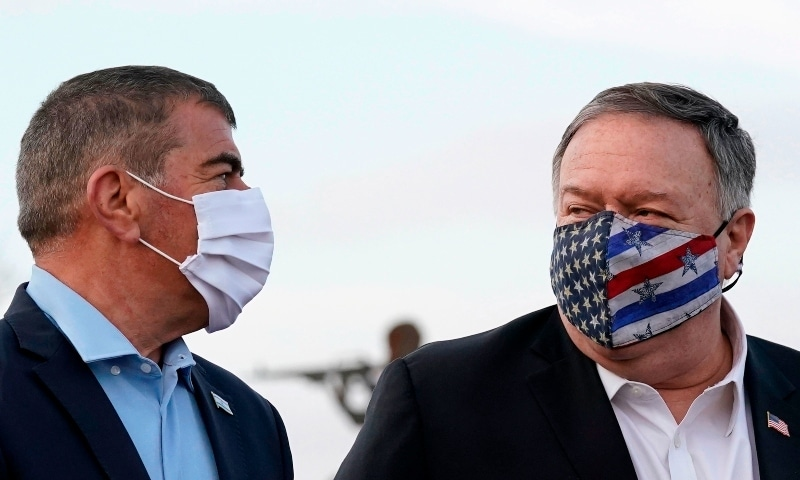 US Secretary of State Mike Pompeo walks with Israeli Foreign Minister Gabi Ashkenazi (L) following a security briefing on Mount Bental in Golan heights on Nov 19. — AFP