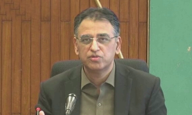 inister for Planning, Development and Special Initiatives Asad Umar speaks to the media. — DawnNewsTV