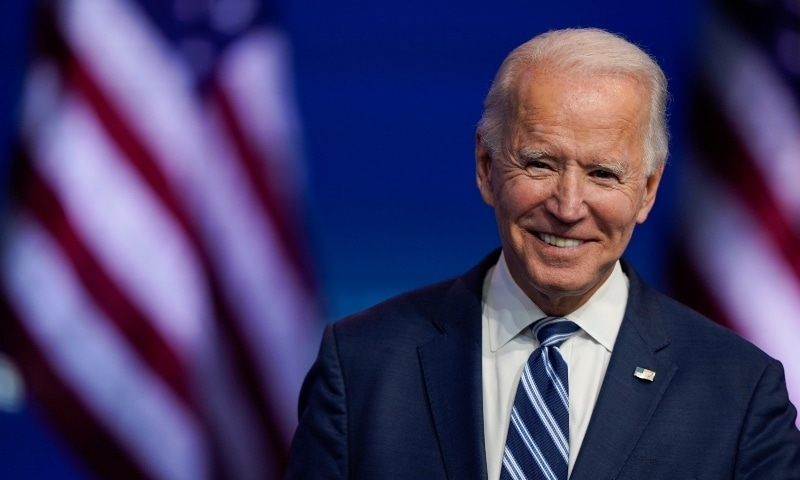 In this November 10 photo, US President-elect Joe Biden smiles as he speaks at The Queen theater in Wilmington, Delaware. — AP