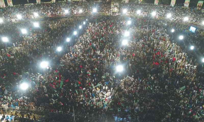 In this file photo, people attend the PDM public meeting at Jinnah Stadium in Gujranwala.— Aun Jafri / White Star