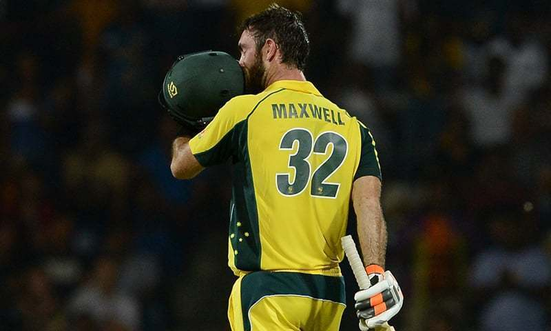 Australia's Glenn Maxwell kisses his helmet after scoring a century (100 runs) during the first T20 international cricket match between Sri Lanka and Australia at the Pallekele International Cricket Stadium in Pallekele on September 6, 2016. — AFP/File