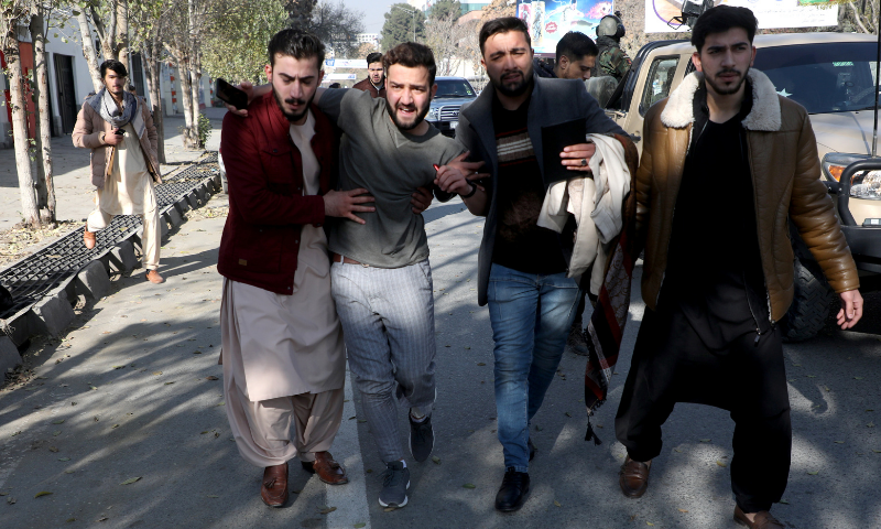 An injured man is carried as he leaves a hospital after rockets hit residential areas in Kabul, Afghanistan on Saturday. — Reuters