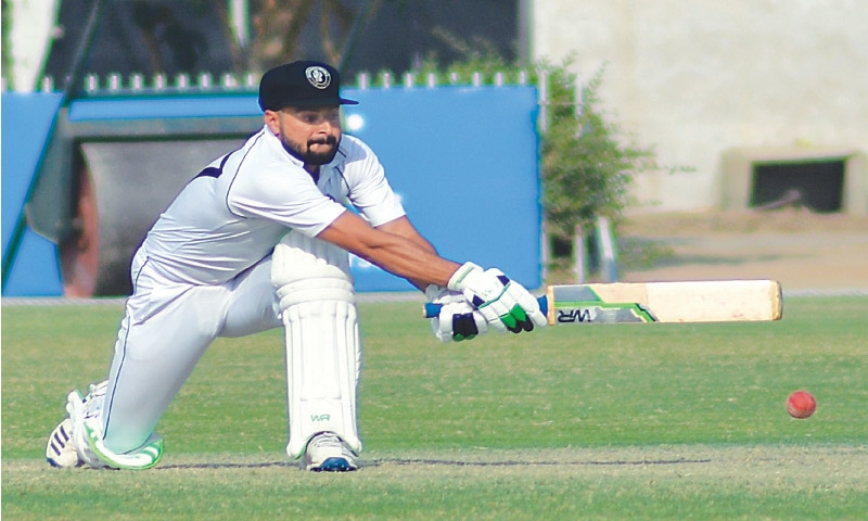 KHYBER Pakhtunkhwa captain Khalid Usman attempts a reverse sweep during his knock of 92 against Central Punjab at the UBL Sports Complex on Saturday. —Courtesy PCB