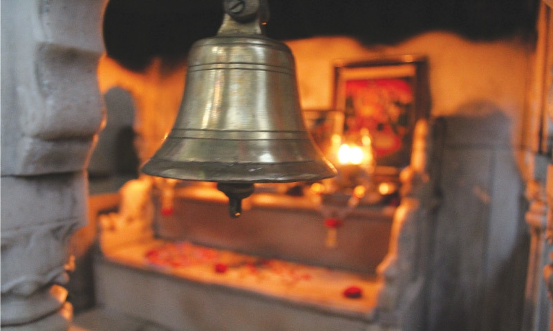 A bell in the temple adjacent to Oderolal's grave