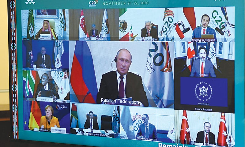 In this official handout, Russian President Vladimir Putin takes part in a video conference during the G20 Leaders' Summit 2020, at the Novo-Ogaryovo state residence outside Moscow on Saturday.