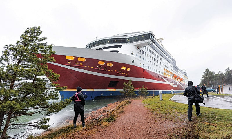 People gather after Viking Line cruise ferry Viking Grace ran aground with some 300 passengers in south of Mariehamn, autonomous Aland Islands territory, Finland. — Reuters
