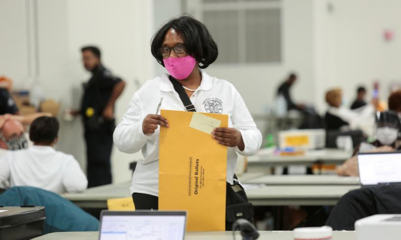 A poll worker supervisor looks on as she handles an envelope of original ballots at the TCF center after Election Day in Detroit, Michigan, US on Nov 4. — Reuters/File