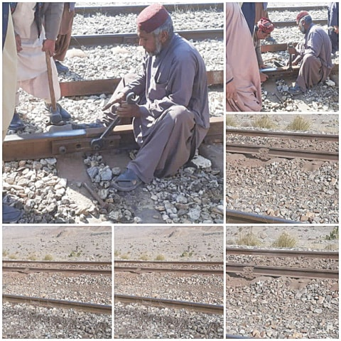 Workers repairing the damaged railway track on Sunday.—Dawn