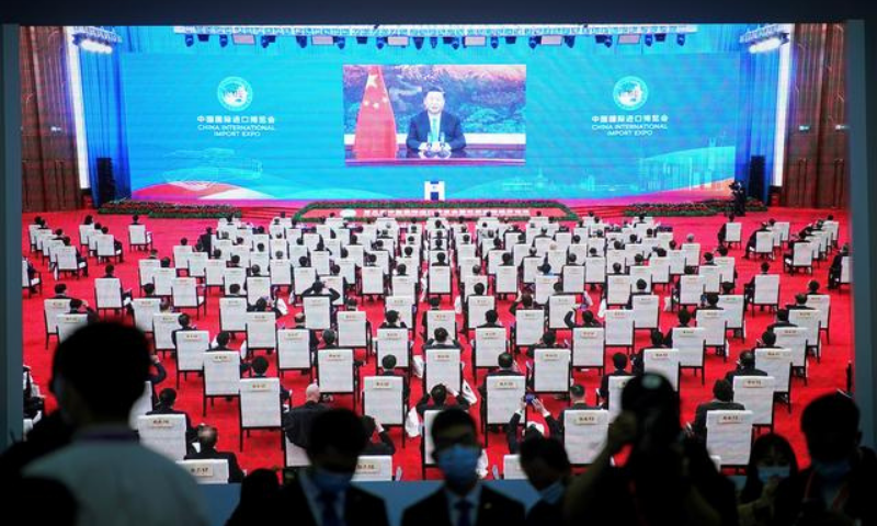 China's President Xi Jinping is seen on a screen in the media center as he speaks at the opening ceremony of the third China International Import Expo (CIIE) in Shanghai, China on Nov 4. — Reuters