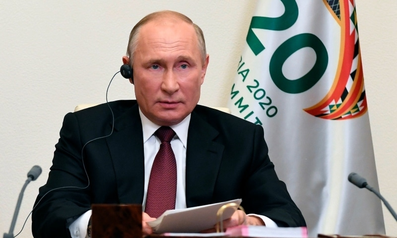 Russian President Vladimir Putin attends the G20 summit hosted by Saudi Arabia via video conference at the Novo-Ogaryovo residence outside Moscow on Nov 21. — AP